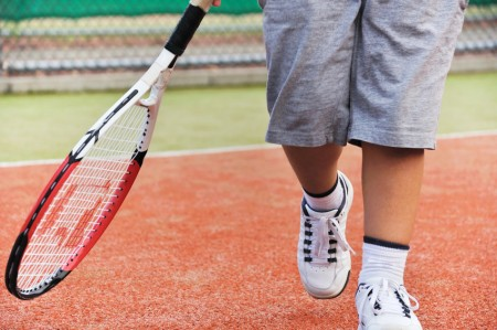 Young boy play tennis