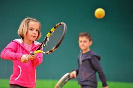 Children at club during a dribble of tennis